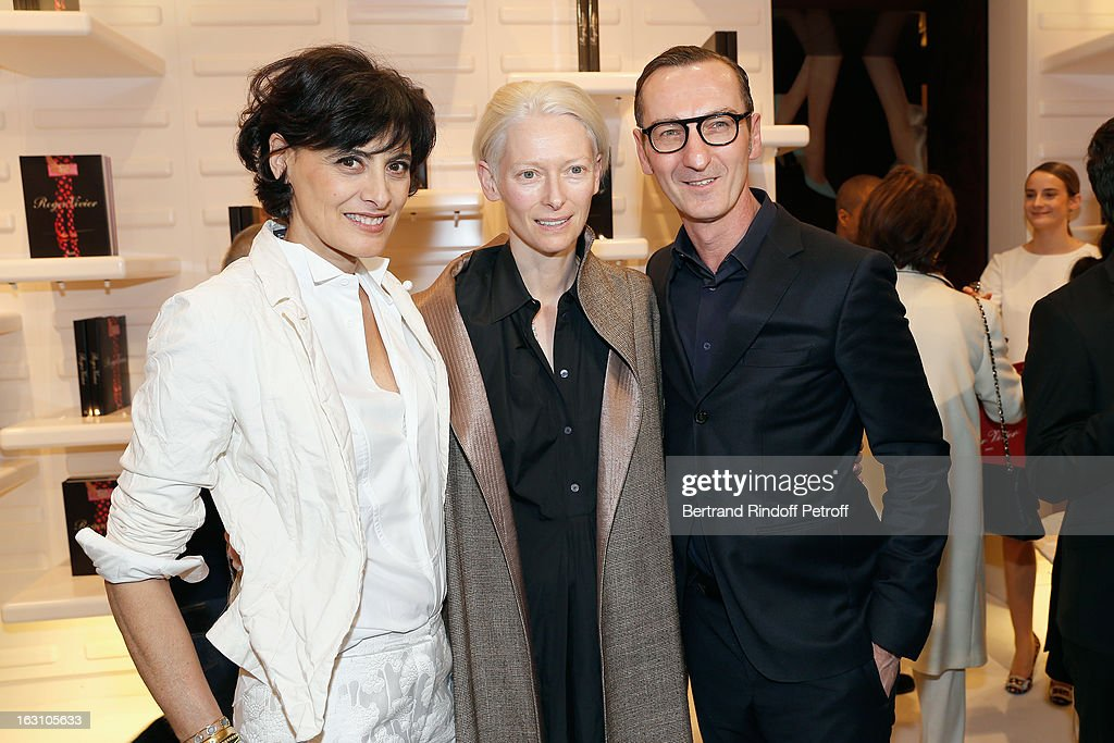 <a gi-track='captionPersonalityLinkClicked' href=/galleries/search?phrase=Ines+de+la+Fressange&family=editorial&specificpeople=2078500 ng-click='$event.stopPropagation()'>Ines de la Fressange</a>, <a gi-track='captionPersonalityLinkClicked' href=/galleries/search?phrase=Tilda+Swinton&family=editorial&specificpeople=202991 ng-click='$event.stopPropagation()'>Tilda Swinton</a> and Bruno Frisoni attend the Roger Vivier Cocktail, to celebrate the launch of the book 'Roger Vivier', as part of Paris Fashion Week on March 4, 2013 in Paris, France.