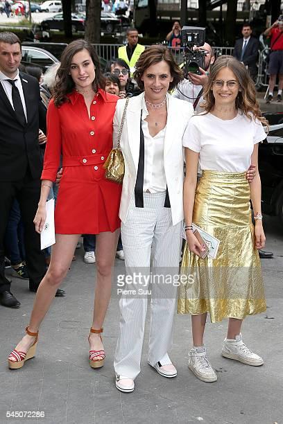 Ines de la Fressange with daughters Nine and Violette d'Urso arrive at the Chanel Haute Couture Fall/Winter 20162017 show as part of Paris Fashion...