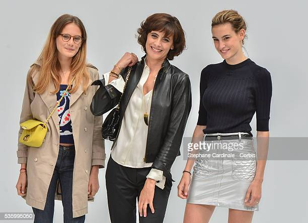 Ines de la Fressange with daughters Nine and Violette d'Urso Chanel show during the Paris Fashion Week Haute Couture Fall/Winter 20142015