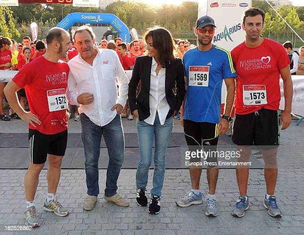 Ines Sastre and Fermin Cacho attend run '2013 Hearst' on September 28 2013 in Madrid Spain