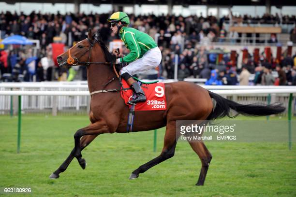 Infamous Angel ridden by Richard Hughes going to post for the 32Redcom Cheveley Park Stakes at Newmarket