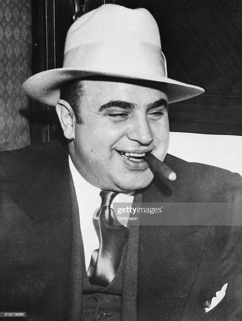 Infamous gangster <a gi-track='captionPersonalityLinkClicked' href=/galleries/search?phrase=Al+Capone&family=editorial&specificpeople=93051 ng-click='$event.stopPropagation()'>Al Capone</a> smokes a cigar on the train carrying him to the federal penitentiary in Atlanta where he will start serving an eleven-year sentence.