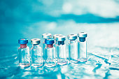 Infant and Childhood Vaccines bottles. Vaccines & Immunization concept