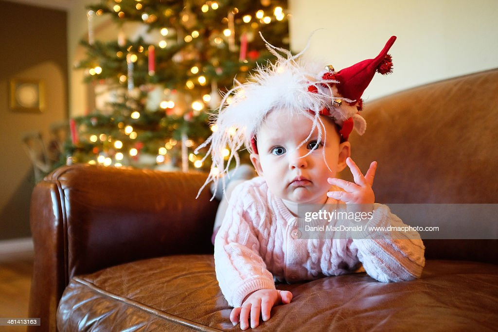 Infant baby girl with festive Christmas hat : Stock Photo
