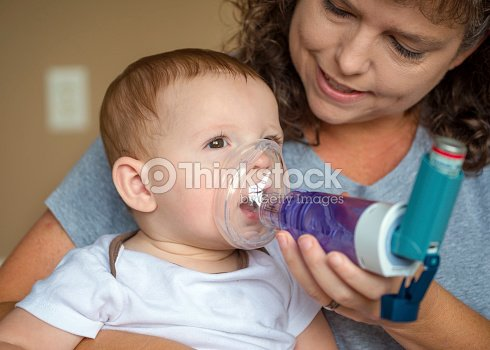 Infant getting breathing treatment from mother stock photo for Chambre d inhalation
