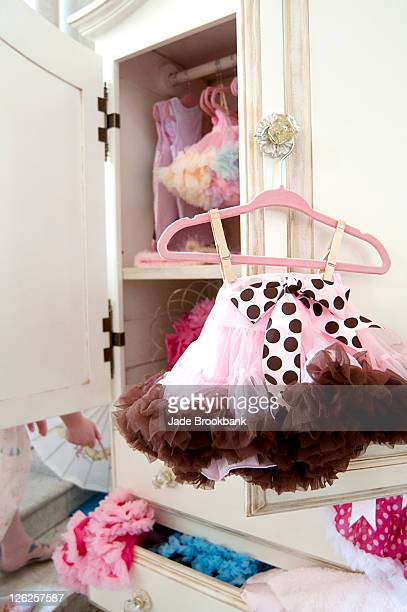 Infant girl clothes hanging in closet