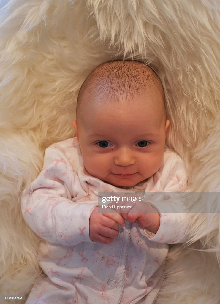 Infant girl smiling : Stock Photo