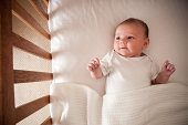 Infant (1 month) laying in crib