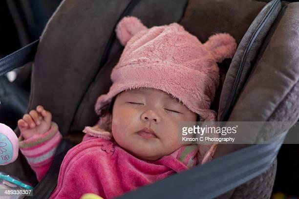Infant sleeps in baby cat seat