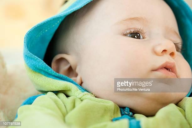 Infant wearing hooded sweatshirt, close-up