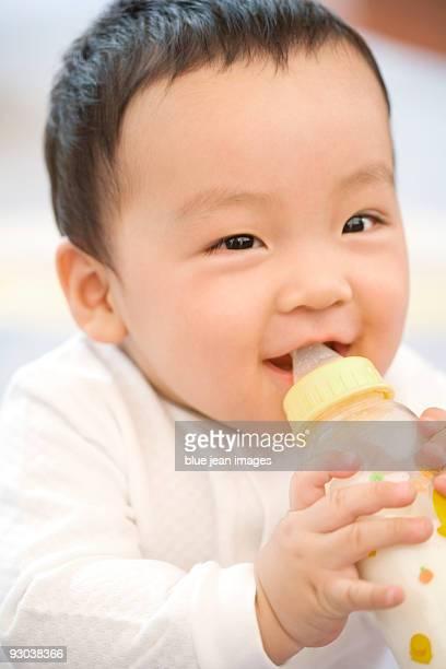 Infant with milk bottle