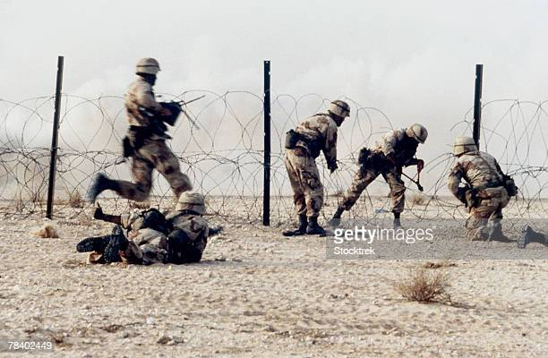Infantry cutting through concertina wire