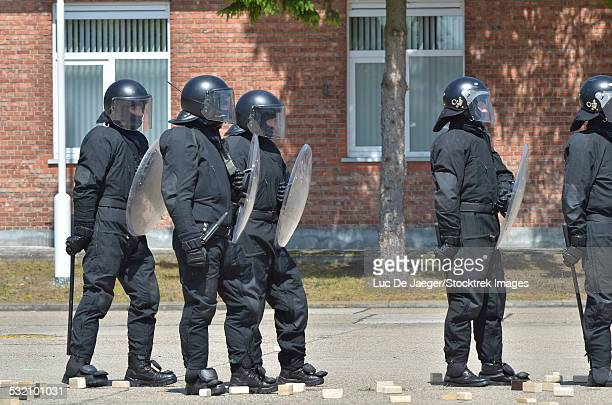 Infantry soldiers of the Belgian Army in riot gear during a training session in Leopoldsburg, Belgium.