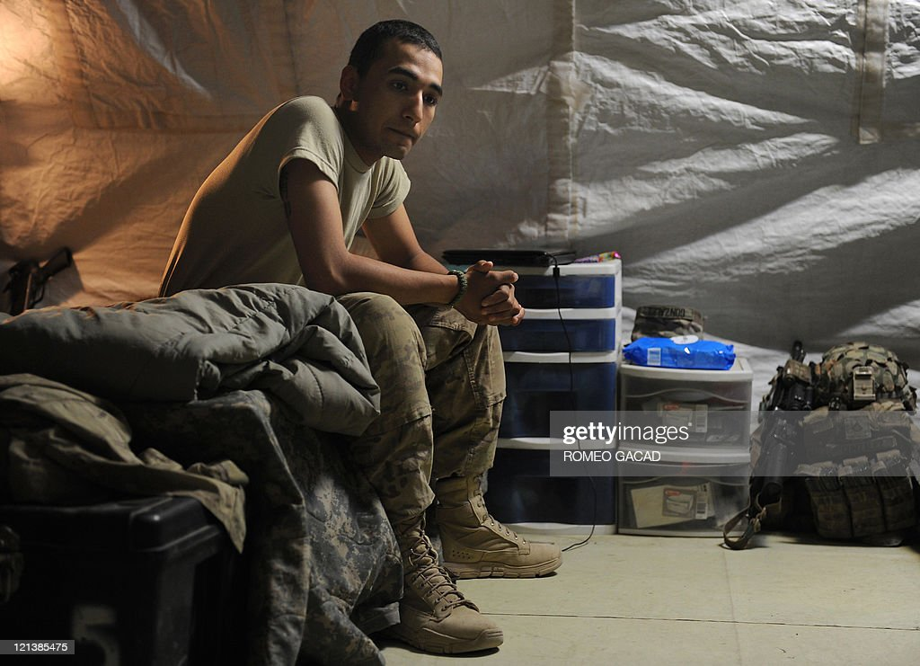 US infantryman Private Julio Gonzalez of Delta Company 287 Infantry Battalion 3rd Brigade Combat Team sits on his bed in the Delta Company barracks...