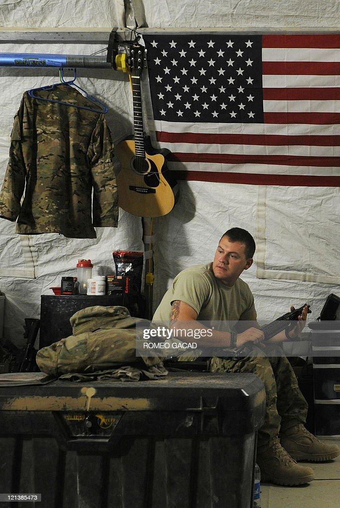 US infantryman Sergeant Darren McIntyre of Delta Company 287 Infantry Battalion 3rd Brigade Combat Team prepares his gun in the Delta Company...