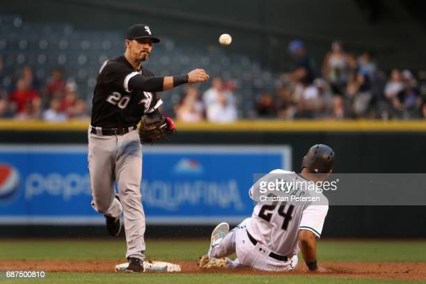 Infeilder Tyler Saladino of the Chicago White Sox throws over the sliding Yasmany Tomas of the Arizona Diamondbacks to complete a double play during...