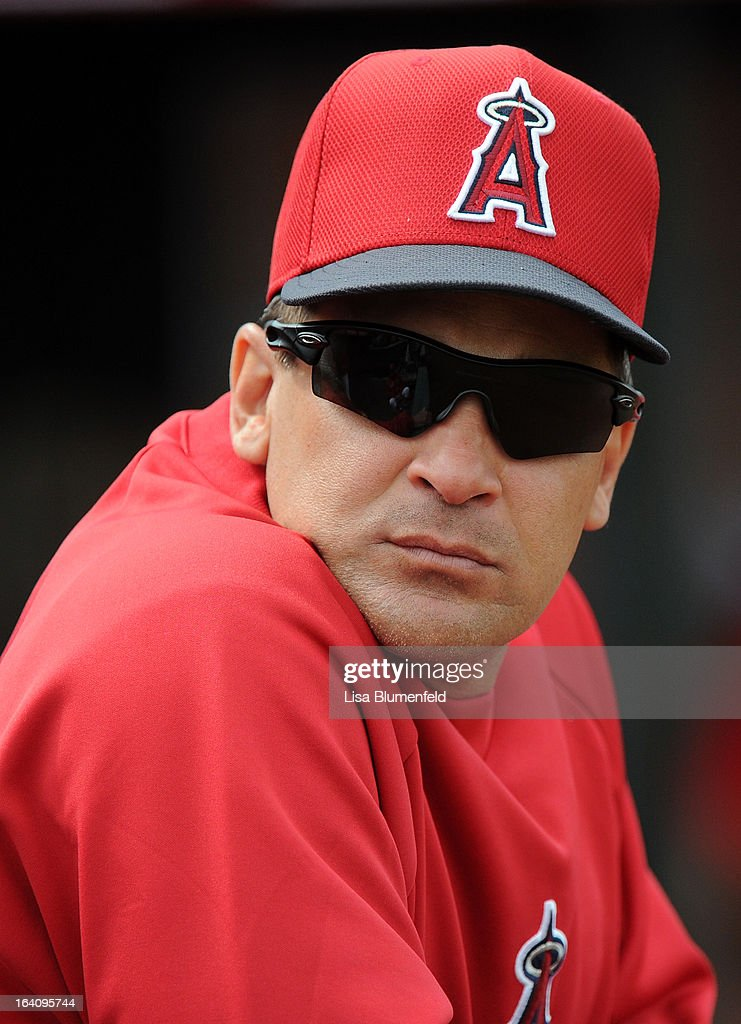 Infield instructor <a gi-track='captionPersonalityLinkClicked' href=/galleries/search?phrase=Omar+Vizquel&family=editorial&specificpeople=201489 ng-click='$event.stopPropagation()'>Omar Vizquel</a> of the Los Angeles Angels of Anaheim looks on during the game against the Colorado Rockies at Tempe Diablo Stadium on March 9, 2013 in Peoria, Arizona.