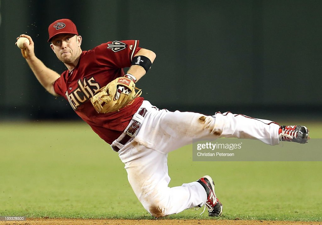 Infielder <a gi-track='captionPersonalityLinkClicked' href=/galleries/search?phrase=Aaron+Hill&family=editorial&specificpeople=239242 ng-click='$event.stopPropagation()'>Aaron Hill</a> #2 of the Arizona Diamondbacks attempts to throw out Charlie Blackmon (not pictured) of the Colorado Rockies after he hit a single during the fifth inning of the MLB game at Chase Field on October 3, 2012 in Phoenix, Arizona.