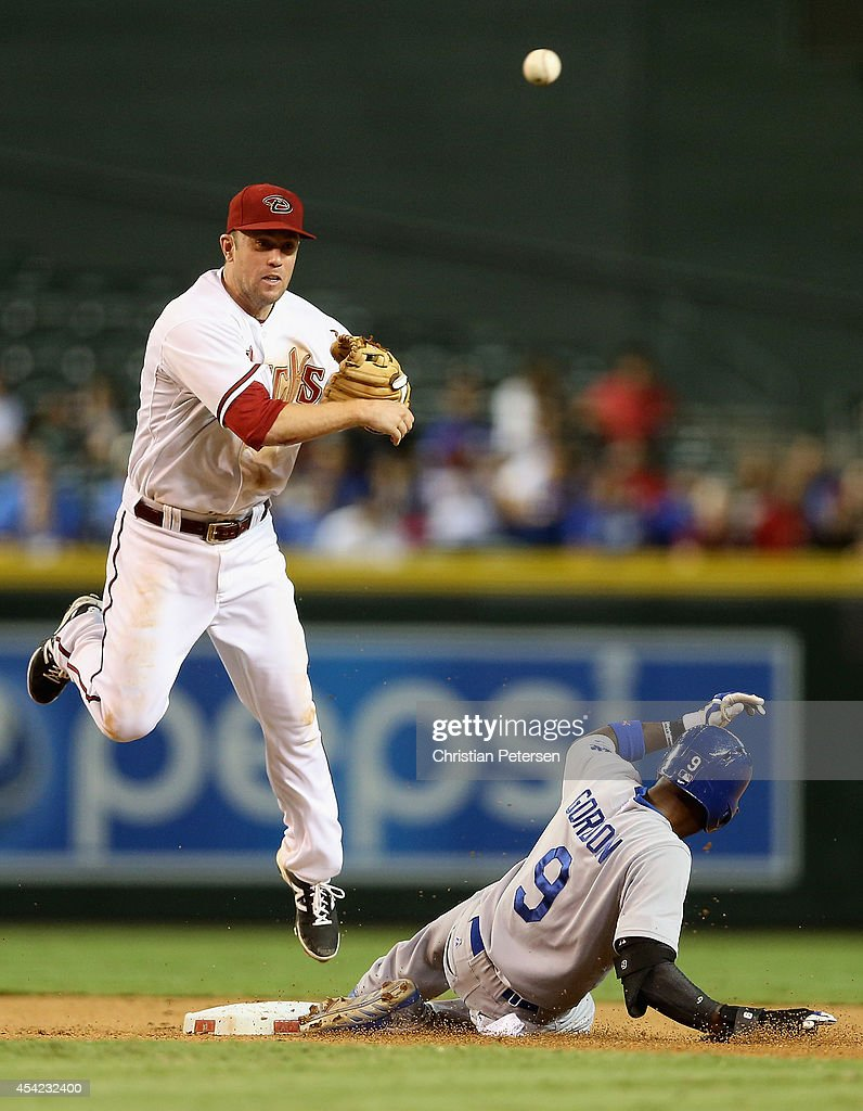 Infielder <a gi-track='captionPersonalityLinkClicked' href=/galleries/search?phrase=Aaron+Hill+-+Baseball+Player&family=editorial&specificpeople=239242 ng-click='$event.stopPropagation()'>Aaron Hill</a> #2 of the Arizona Diamondbacks throws over the sliding <a gi-track='captionPersonalityLinkClicked' href=/galleries/search?phrase=Dee+Gordon&family=editorial&specificpeople=7091343 ng-click='$event.stopPropagation()'>Dee Gordon</a> #9 of the Los Angeles Dodgers to complete a double play during the eighth inning of the MLB game at Chase Field on August 26, 2014 in Phoenix, Arizona.