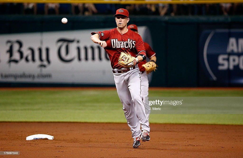 Infielder <a gi-track='captionPersonalityLinkClicked' href=/galleries/search?phrase=Aaron+Hill+-+Baseball+Player&family=editorial&specificpeople=239242 ng-click='$event.stopPropagation()'>Aaron Hill</a> #2 of the Arizona Diamondbacks throws over to first for an out against the Tampa Bay Rays during the game at Tropicana Field on July 31, 2013 in St. Petersburg, Florida.