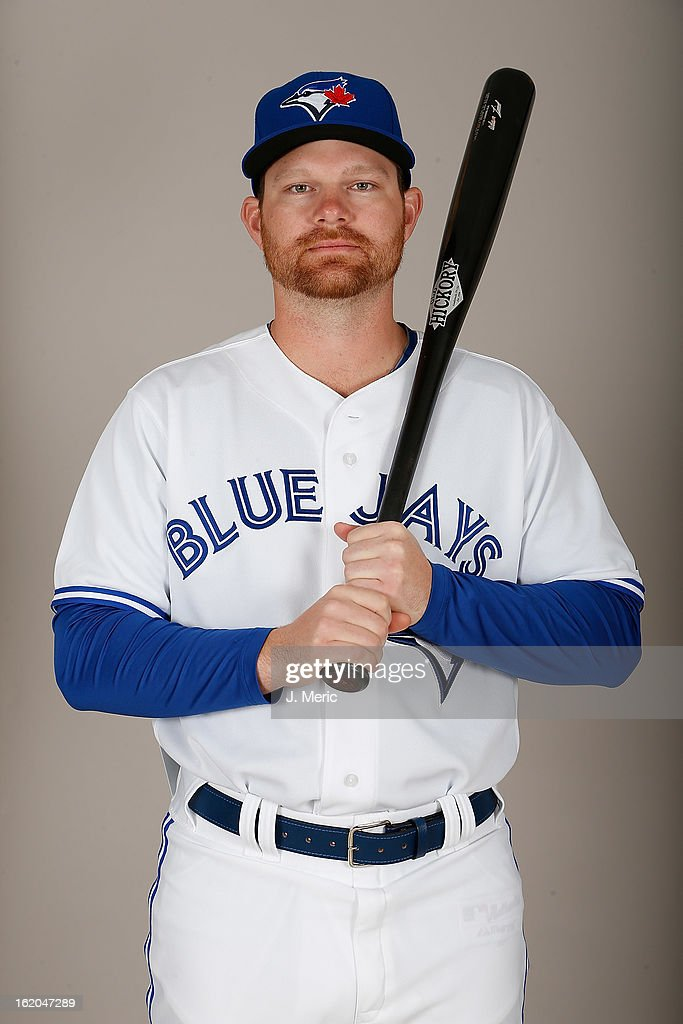 Infielder <a gi-track='captionPersonalityLinkClicked' href=/galleries/search?phrase=Adam+Lind&family=editorial&specificpeople=3911783 ng-click='$event.stopPropagation()'>Adam Lind</a> #26 of the Toronto Blue Jays poses for a photo during photo day at Florida Auto Exchange Stadium on February 18, 2013 in Dunedin, Florida.