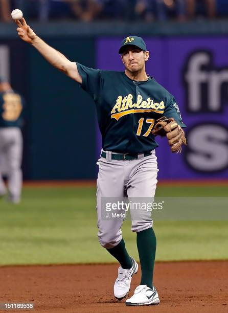Infielder Adam Rosales of the Oakland Athletics throws the ball against the Tampa Bay Rays during the game at Tropicana Field on August 24 2012 in St...