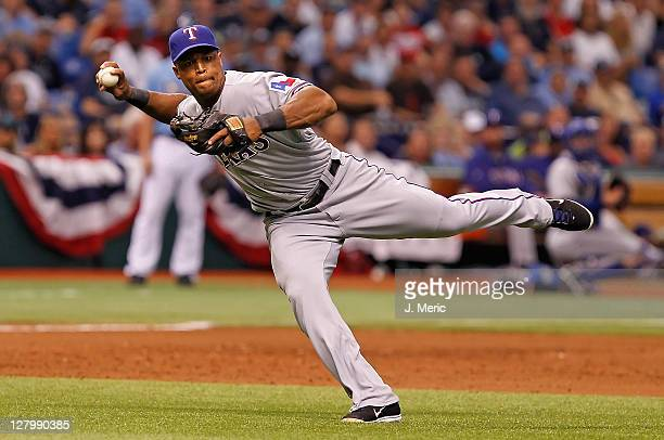 Infielder Adrian Beltre of the Texas Rangers throws over to first for an out against the Tampa Bay Rays during Game Four of the American League...