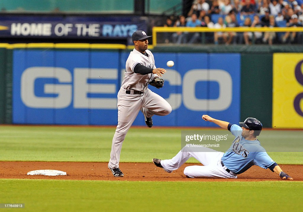 Infielder Alberto Nunez #26 of the New York Yankees throws to 1st base for a double play against the Tampa Bay Rays bats August 25, 2013 at Tropicana Field in St. Petersburg, Florida.