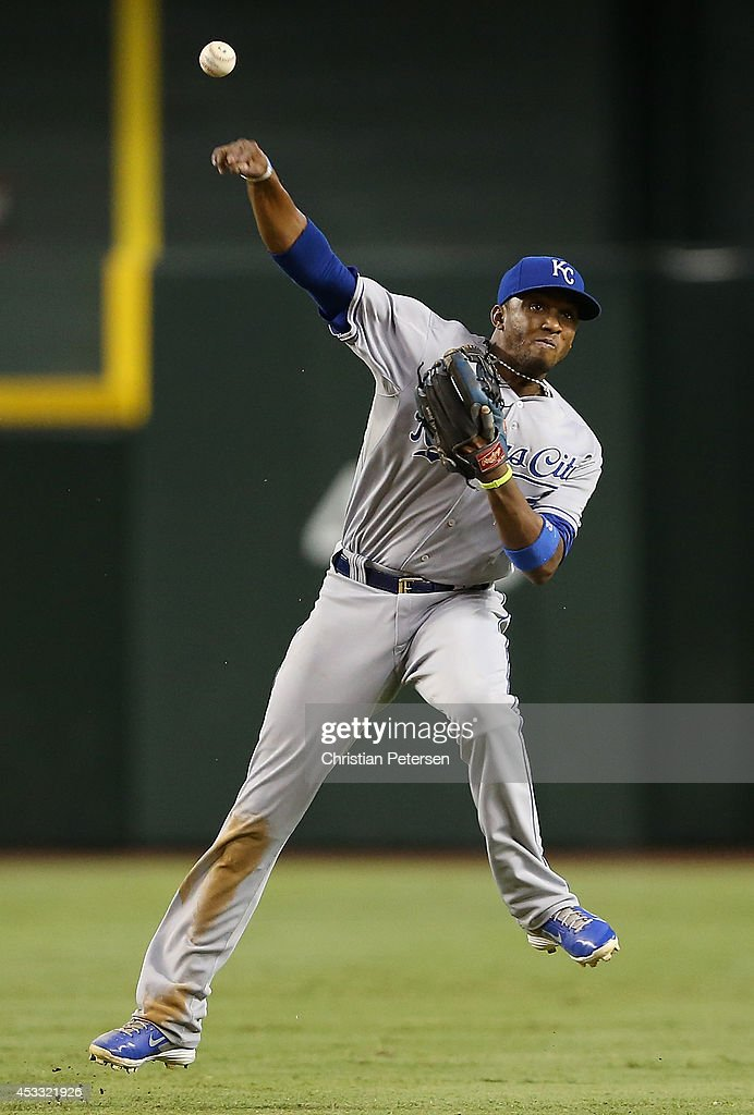 Infielder Alcides Escobar #2 of the Kansas City Royals fields a ground ball out against the Arizona Diamondbacks during the eighth inning of the MLB game at Chase Field on August 7, 2014 in Phoenix, Arizona. The Royals defeated the Diamondbacks 6-2.