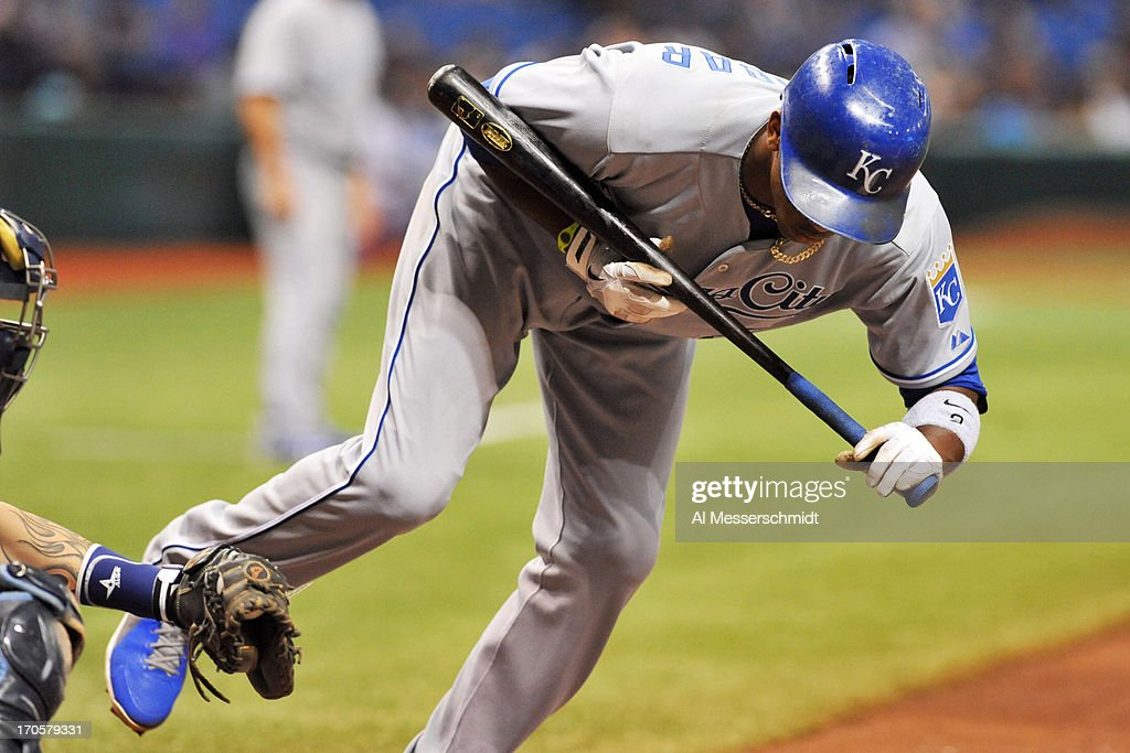 Infielder <a gi-track='captionPersonalityLinkClicked' href=/galleries/search?phrase=Alcides+Escobar&family=editorial&specificpeople=4845889 ng-click='$event.stopPropagation()'>Alcides Escobar</a> #2 of the Kansas City Royals jumps away from an inside pitch against the Tampa Bay Rays June 14, 2013 at Tropicana Field in St. Petersburg, Florida.