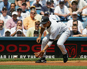 Infielder Alex Rodriguez of the New York Yankees fields the ball against the Detroit Tigers during the game at Yankee Stadium on July 7 2004 in the...