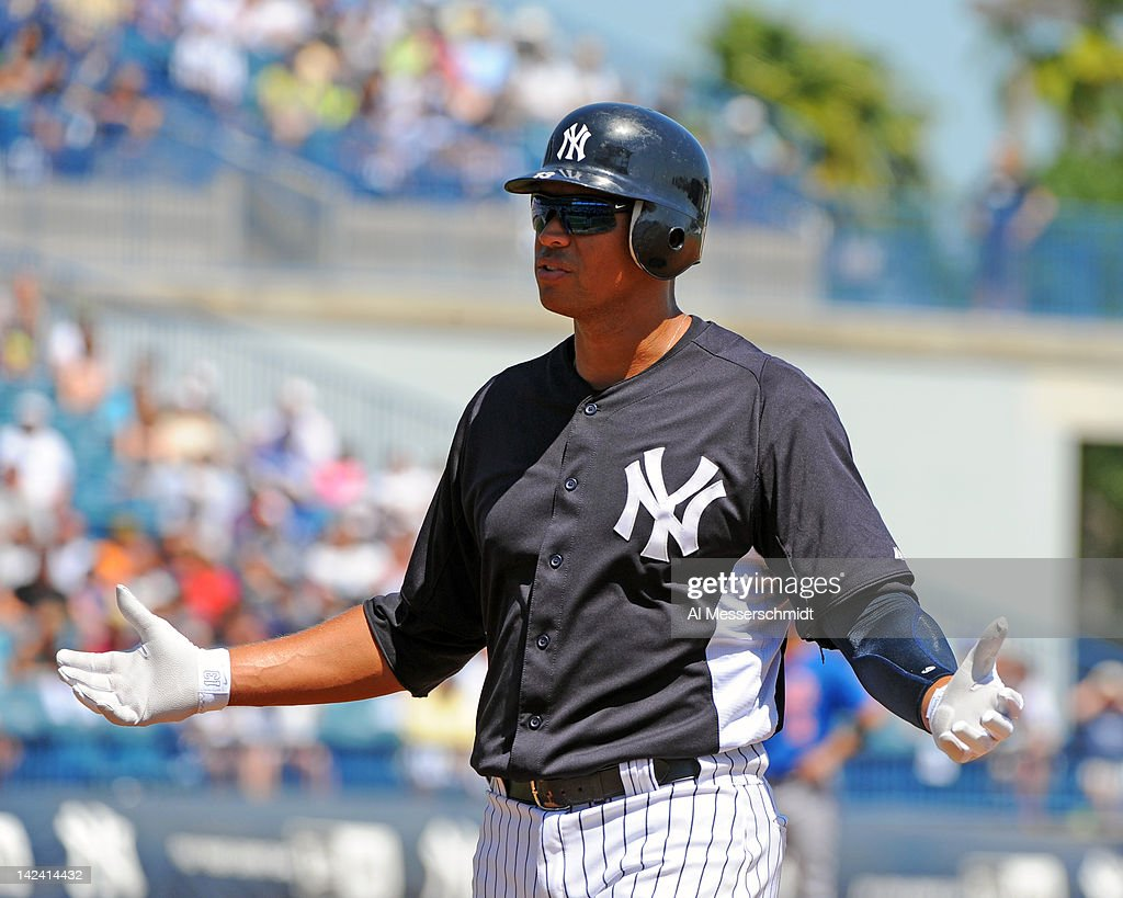 Infielder Alex Rodriguez #13 of the New York Yankees leads off first base against the New York Mets in a spring training game April 4, 2012 at George M. Steinbrenner Field in Tampa, Florida.