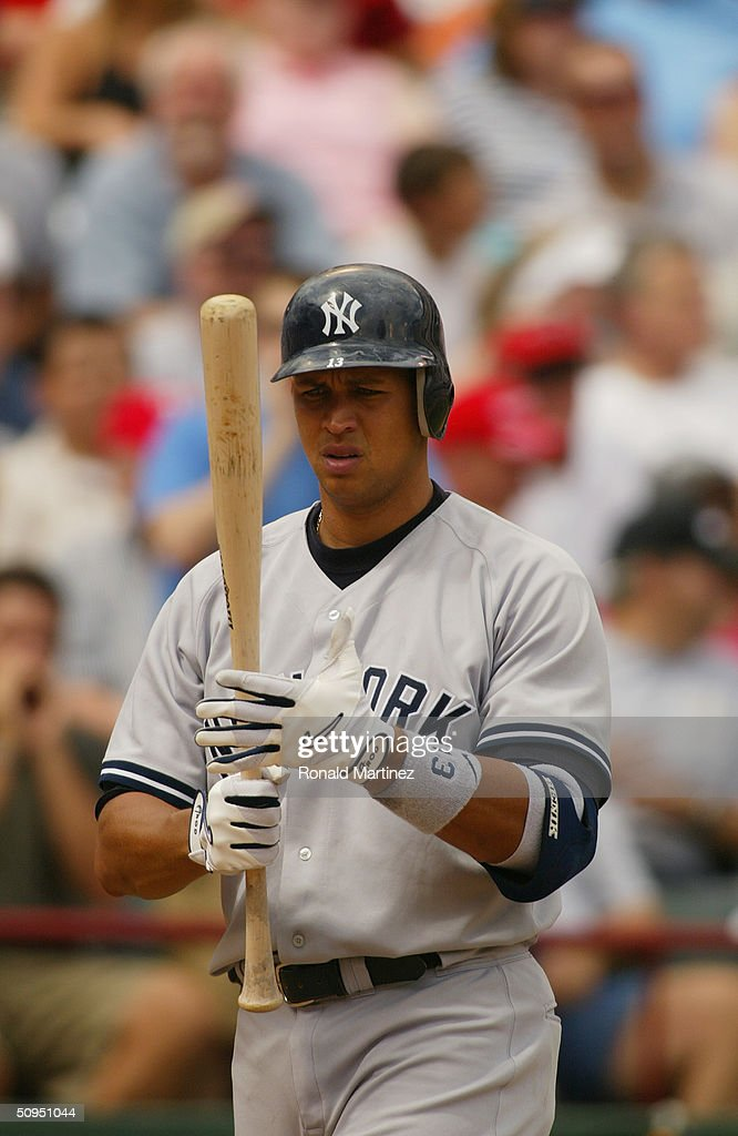 Infielder Alex Rodriguez of the New York Yankees looks at the bat during the game against the Texas Rangers at Ameriquest Field in Arlington on May...