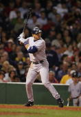 Infielder Alex Rodriguez of the New York Yankees swings at a Boston Red Sox pitch during the game at Fenway Park on September 24 2004 in Boston...
