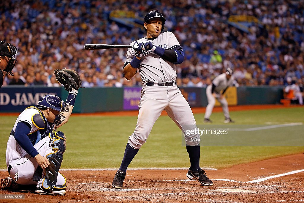 Infielder Alex Rodriguez #13 of the New York Yankees takes an inside pitch against the Tampa Bay Rays during the game at Tropicana Field on August 23, 2013 in St. Petersburg, Florida.