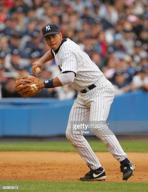 Infielder Alex Rodriguez of the New York Yankees throws the ball against the Texas Rangers during the game at Yankee Stadium on June 6 2004 in Bronx...