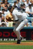 Infielder Alex Rodriguez of the New York Yankees throws the ball against the Detroit Tigers during the game at Yankee Stadium on July 7 2004 in the...