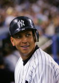 Infielder Alex Rodriguez of the New York Yankees watches the game against the Boston Red Sox at Yankee Stadium on July 1 2004 in the Bronx New York...
