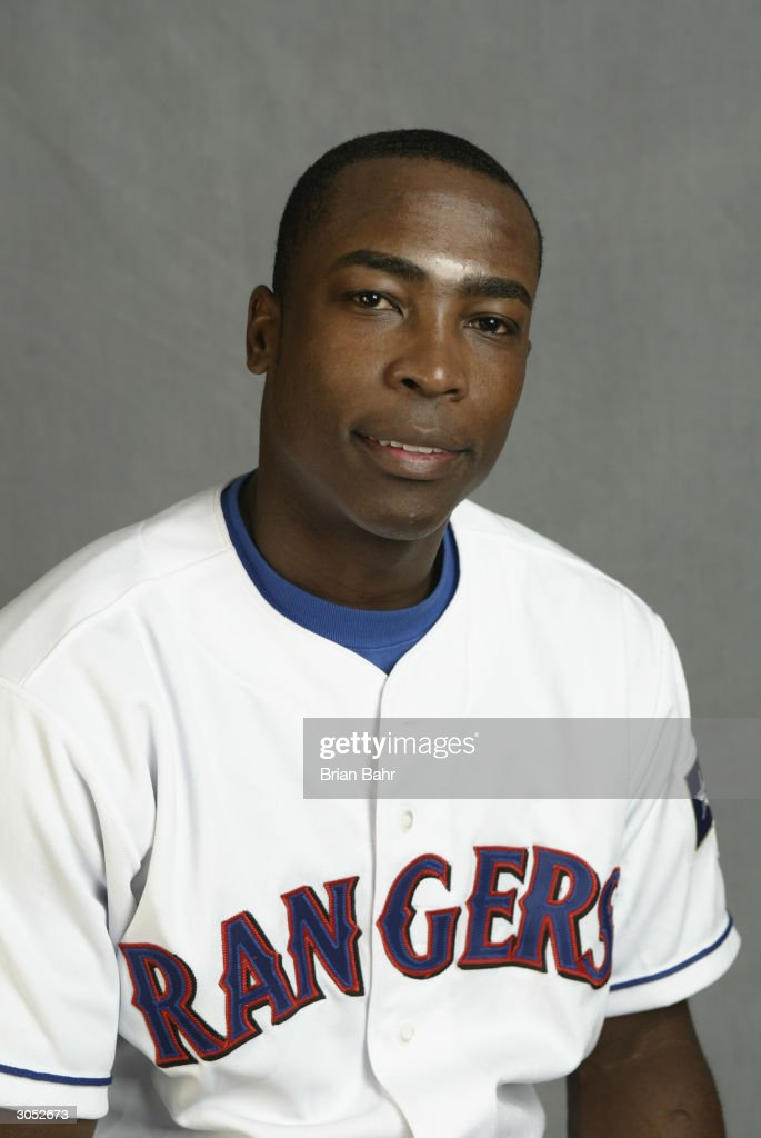 Infielder Alfonso Soriano #12 of the Texas Rangers poses for a picture during Texas Rangers Media Day at Surprise Stadium on February 26, 2004 in Surprise, Arizona.