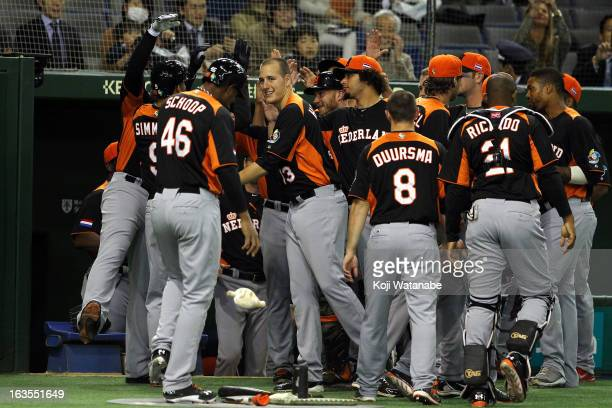 Infielder Andrelton Simmons of the Netherlands celebrates with teammates after scoring a homerun in the top half of the first inning during the World...