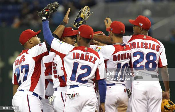 Infielder Andy Ibanez Yasmany Tomas Yulieski Gourriel pitcher Raciel Iglesias and other players celebrate victory over Chinese Taipei in the World...