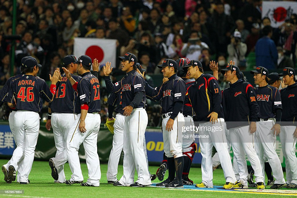 Infielder Atsunori Inaba #41 and Infielder Takashi Toritani #1 of Japan celebrates with teammates after their win during the World Baseball Classic First Round Group A game between Brazil and Japan at Fukuoka Yahoo! Japan Dome on March 2, 2013 in Fukuoka, Japan.