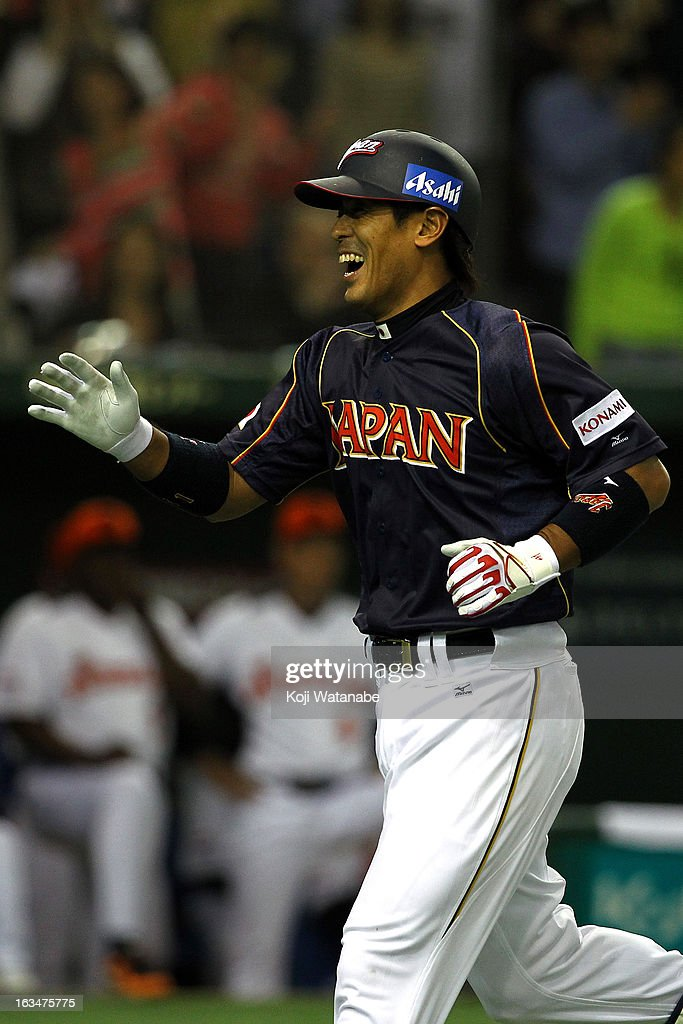 Infielder Atsunori Inaba #41 of Japan celebrates after scoring a homer in the top of the third inning during the World Baseball Classic Second Round Pool 1 game between Japan and the Netherlands at Tokyo Dome on March 10, 2013 in Tokyo, Japan.