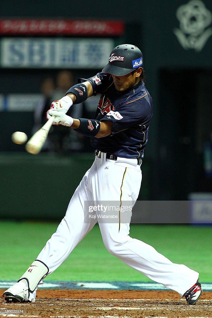 Infielder <a gi-track='captionPersonalityLinkClicked' href=/galleries/search?phrase=Atsunori+Inaba&family=editorial&specificpeople=4009767 ng-click='$event.stopPropagation()'>Atsunori Inaba</a> #41 of Japan hits a single in the top half of the fourth inning during the World Baseball Classic First Round Group A game between Japan and Cuba at Fukuoka Yahoo! Japan Dome on March 6, 2013 in Fukuoka, Japan.