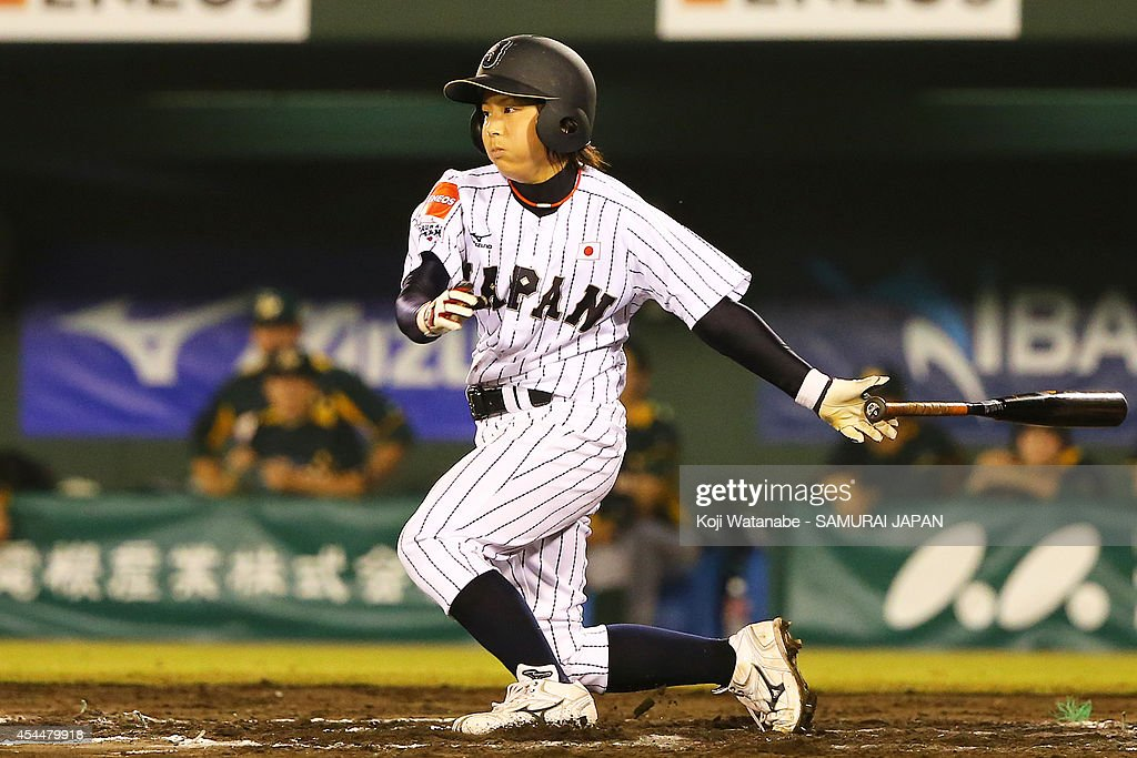 Infielder <a gi-track='captionPersonalityLinkClicked' href=/galleries/search?phrase=Ayako+Rokkaku&family=editorial&specificpeople=9136170 ng-click='$event.stopPropagation()'>Ayako Rokkaku</a> #36 of Japan two-run singel during in the top half of the sixth inning the IBAF Women's Baseball World Cup Group A game between Japan and Australia at Sun Marine Stadium on September 1, 2014 in Miyazaki, Japan.