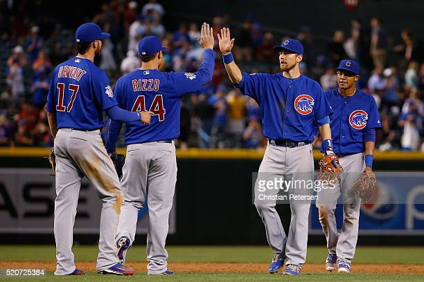 Infielder Ben Zobrist of the Chicago Cubs highfives Anthony Rizzo and Kris Bryant after defeating the Arizona Diamondbacks 73 in the MLB game at...