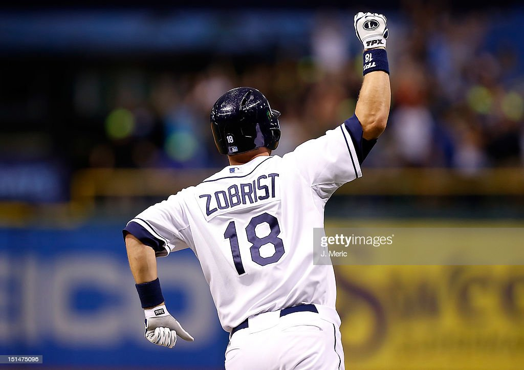 Infielder <a gi-track='captionPersonalityLinkClicked' href=/galleries/search?phrase=Ben+Zobrist&family=editorial&specificpeople=2120037 ng-click='$event.stopPropagation()'>Ben Zobrist</a> #18 of the Tampa Bay Rays celebrates his walk off home run against the Texas Rangers during the game at Tropicana Field on September 7, 2012 in St. Petersburg, Florida.