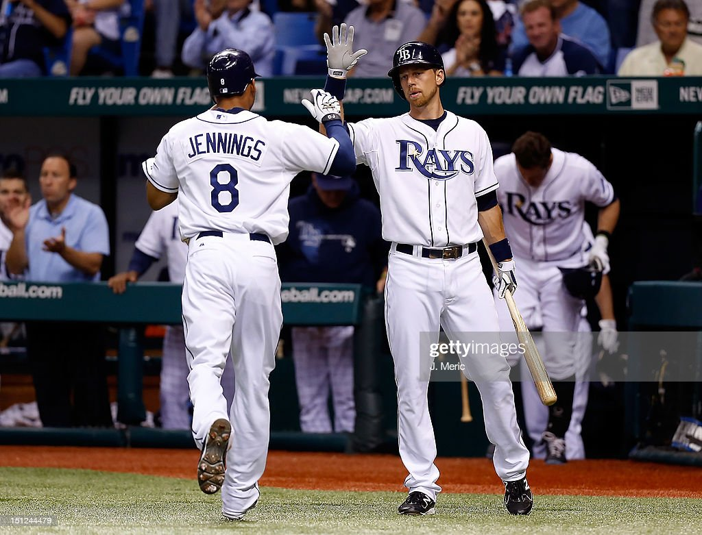 Infielder Ben Zobrist #18 of the Tampa Bay Rays congratulates Desmond Jennings #8 after he scored against the New York Yankees during the game at Tropicana Field on September 4, 2012 in St. Petersburg, Florida.