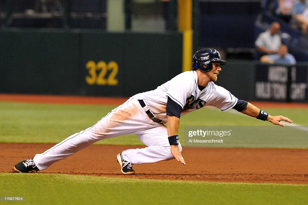 Infielder Ben Zobrist #18 of the Tampa Bay Rays dives to first base during a pickoff attempt by the Kansas City Royals June 14, 2013 at Tropicana Field in St. Petersburg, Florida.