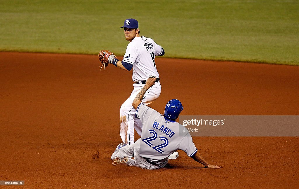 Infielder <a gi-track='captionPersonalityLinkClicked' href=/galleries/search?phrase=Ben+Zobrist&family=editorial&specificpeople=2120037 ng-click='$event.stopPropagation()'>Ben Zobrist</a> #18 of the Tampa Bay Rays forces catcher <a gi-track='captionPersonalityLinkClicked' href=/galleries/search?phrase=Henry+Blanco&family=editorial&specificpeople=211366 ng-click='$event.stopPropagation()'>Henry Blanco</a> #22 of the Toronto Blue Jays at second base during the game at Tropicana Field on May 9, 2013 in St. Petersburg, Florida.